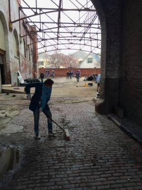 Volunteers are getting the courtyard of the abandoned Tennessee Brewery ready for visitors.
