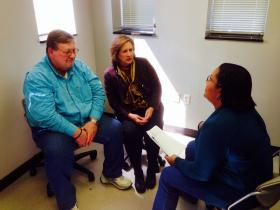 Nursing student Jennifer McClennon (left) speaks with two actors playing the role of patients in a new program at UT that gets health care workers to ask questions about end of life issues.