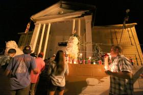 "On August 12, a vigil was held outside of Paul McLeod's Graceland Too in honor of the self-proclaimed ""World's Number One Elvis Fan."""