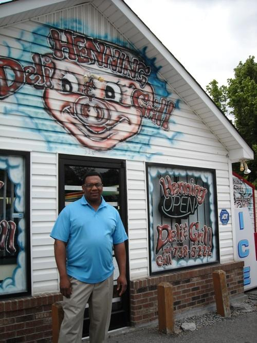 Keith Alston stands outside his shop on Main Street in Henning, TN.