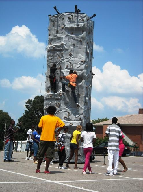 A rock-climbing wall was one of the attractions set up for the Achievement School District picnic in Frayser.