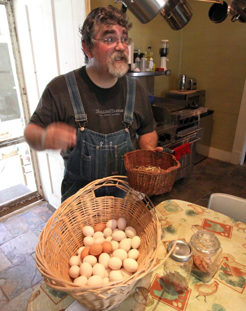 "Dennis Clark shows off the eggs that will be going to St. Mary's Episcopal Cathedral's ""Chicken Ministry."""