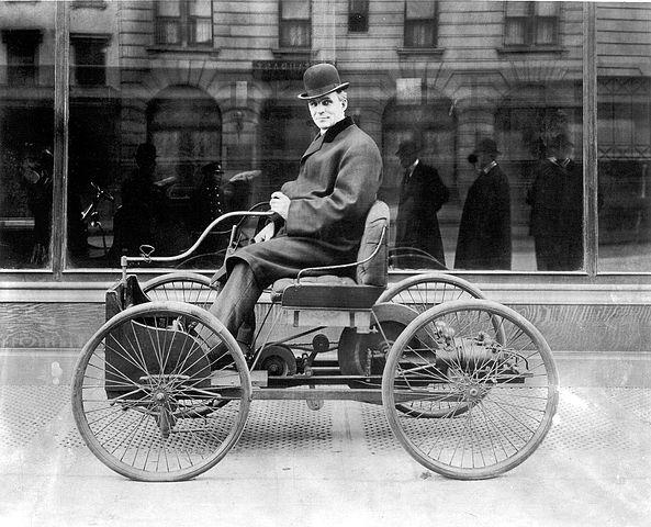 Henry Ford sits in his first automobile, the Ford Quadricycle, in 1896.