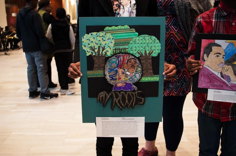 """K'Teria displays her piece, """"My Roots,"""" based on her inspirations of strong, black women and MLK."""