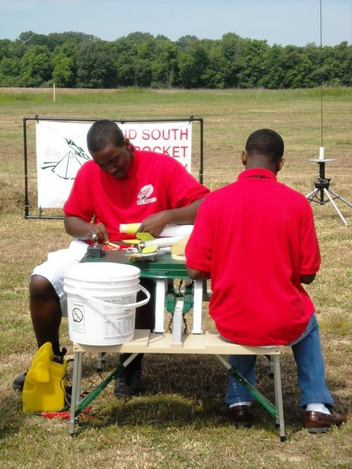 Wooddale High School seniors Darius Hooker (Left) and Wesley Carter (Right) make adjustments to their rocket before take off.