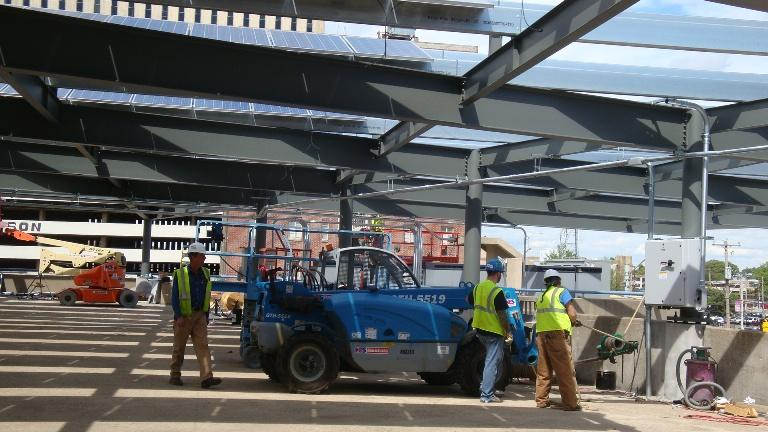 Terry Patrick and his crew install nearly 3,000 solar panels atop the Memphis Bioworks' parking garage in Memphis.