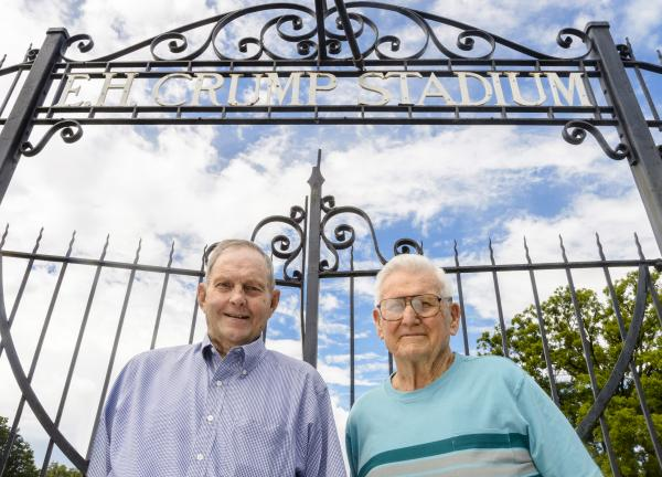 Robert Humphreys (left) and Fred Medling, outside E.H. Crump Stadium, on August 31, 2013. The stadium was the site of the mass swearing-in ceremony by the 1942 Memphis State football team.