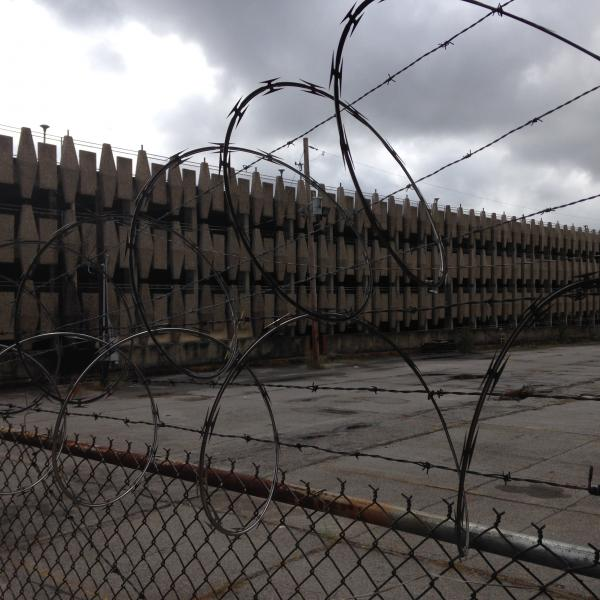 Barbed wire keeps intruders out of the old Sears warehouse.