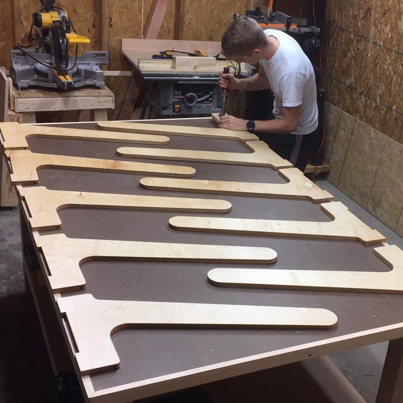 JASWIG's Tyler Schimmoeller builds legs for the prototype desks.