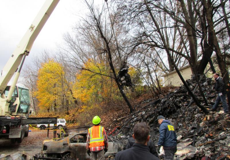 Crews clean up debris from November's Akron plane crash