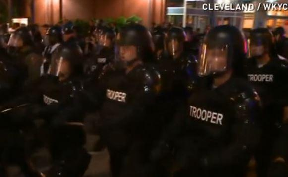 Police advancing on protesters after the Michael Brelo verdict