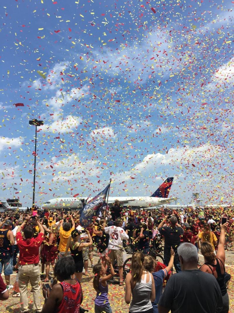 Cavs return home with championship