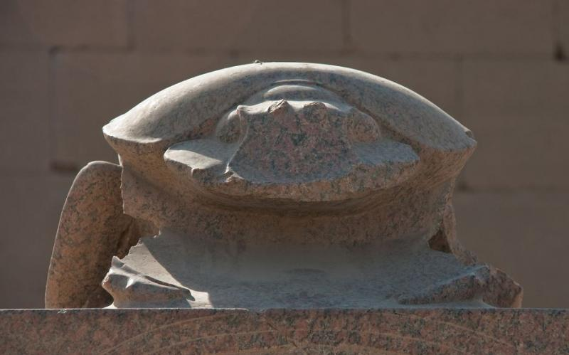 A large scarab statue sits at the temple of Amun at Karnak.  The scarab is among the oldest Egyptian deities.