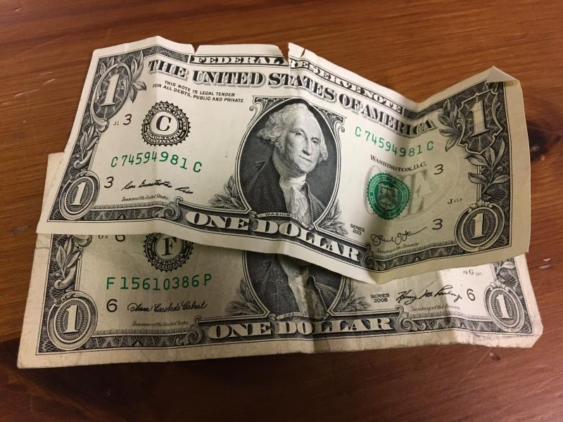 photo of two $1 bills