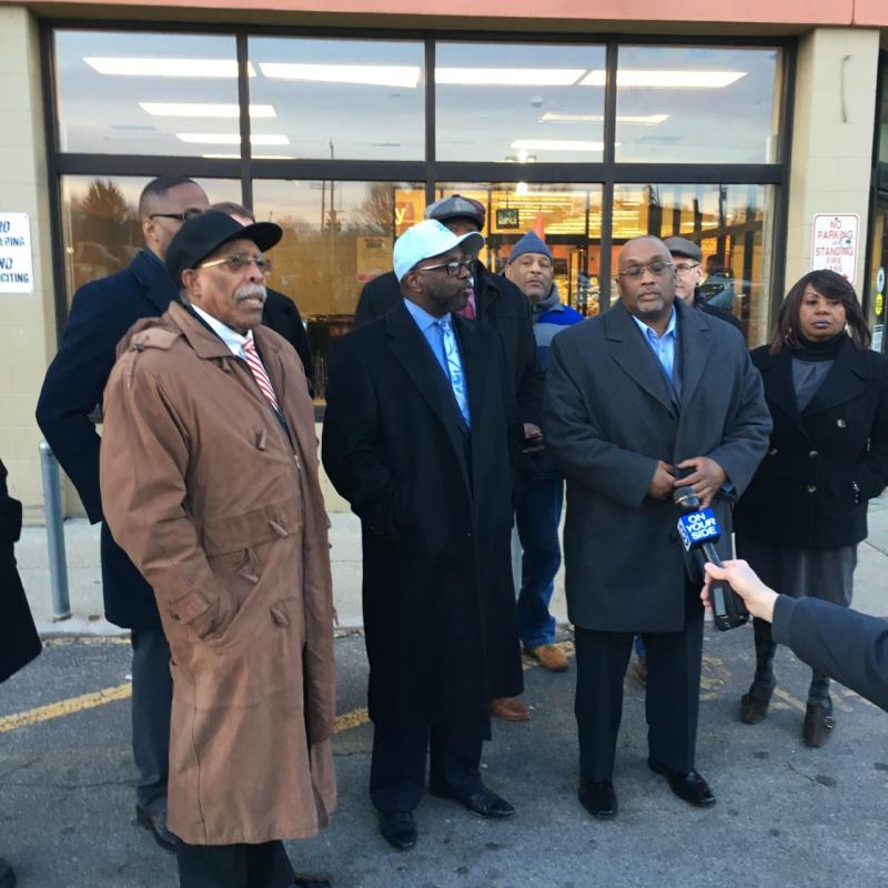 Rev. Jimmy Gates (center) talks in front of the Giant Eagle on Buckeye Road about the impact its closing will have on residents. He's surrounded by other members of the clergy and Cleveland City Council.