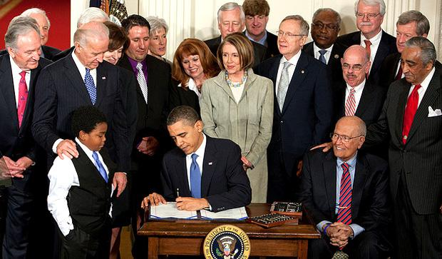 President Obama signs the AFA