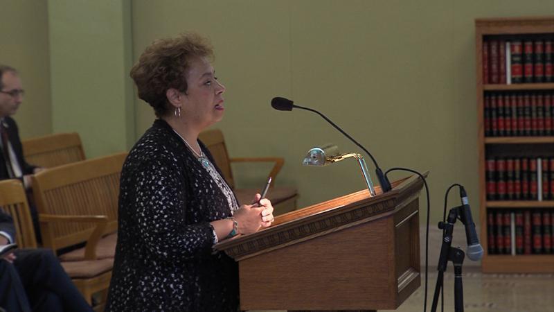 senator charleta tavares at a podium