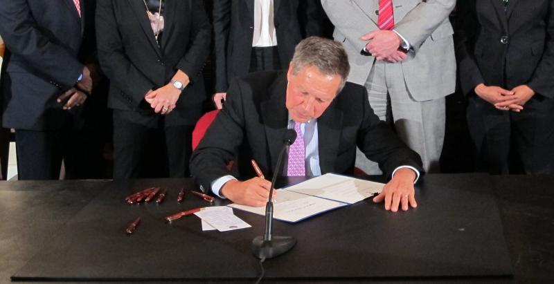 photo of Gov. Kasich signing bills