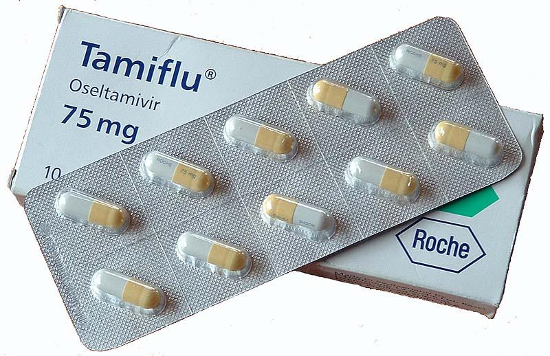 A photo of Tamiflu packaging and pills.