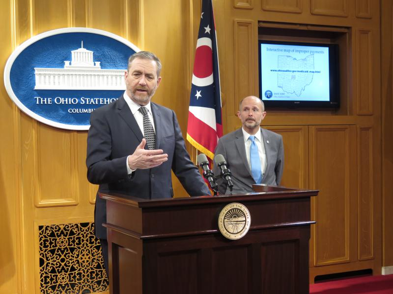 A photo of Auditor Dave Yost (left) discusses the bill alongside Sen. Dave Burke (R-Marysville), the chair of the committee hearing the bill.