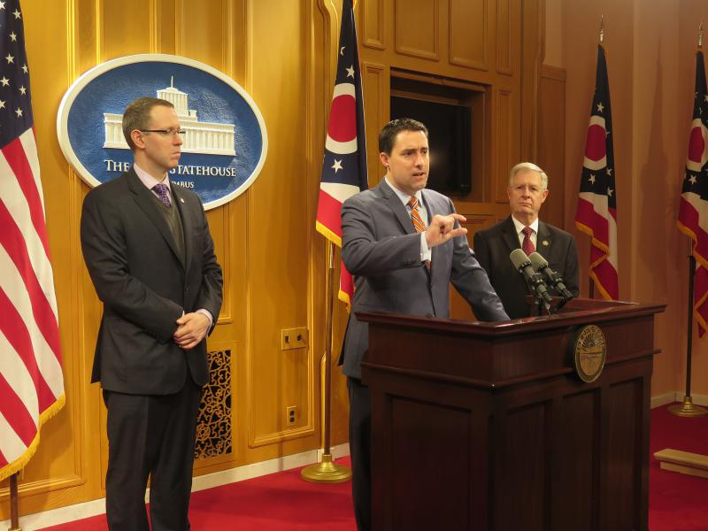 A photo of : Sen. Frank LaRose (R-Hudson) gestures at a news conference with two supporters of his plan, Rep. Louis Blessing (R-Colerain) and Rep. Steve Arndt (R-Port Clinton).