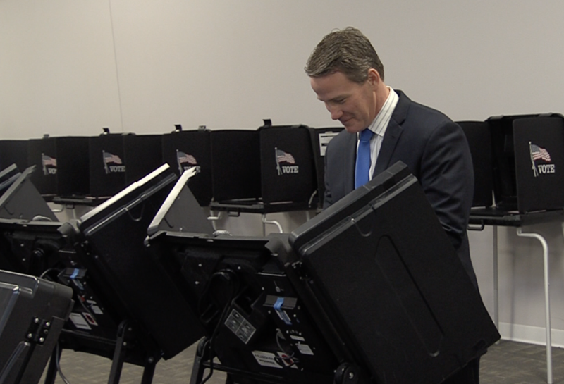 A photo of Secretary of State Jon Husted (R-Ohio) casting an early in-person absentee ballot at the Franklin County Board of Elections early voting center.