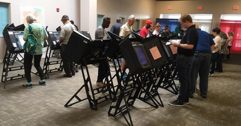 Photo of people voting