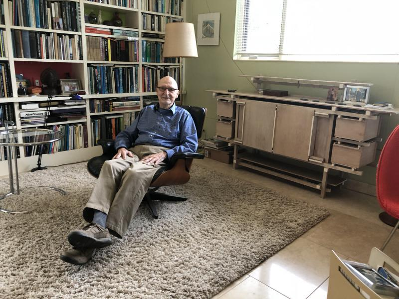 Peter van Dijk sits in an original Eames chair at his home in Cleveland.