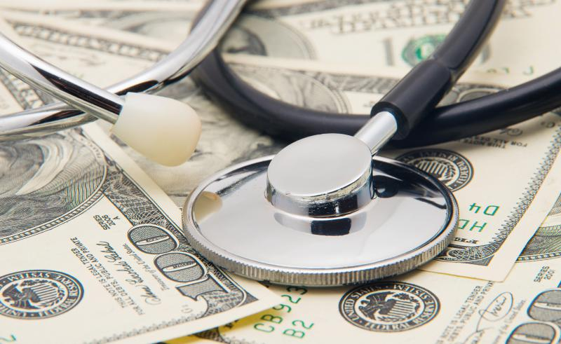 photo of stethoscope and money