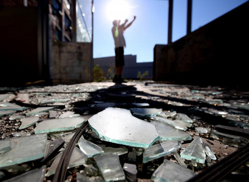 photo of broken glass on the ground outside abandonned factory