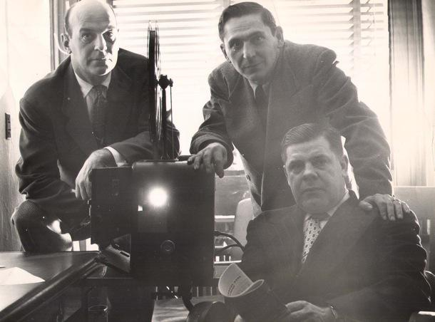 A photo of Paul Brown (left) reviewing football films with Fritz Heisler and Weeb Ewbank, 1951.