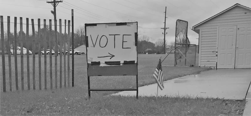 photo of vote sign outside Hudson polling station