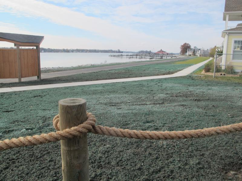 Buckeye Lake, with the newly reinforced earthen dam. The dam, which falls between the sidewalk and the water, was strengthened and put more space between homes and the shoreline.