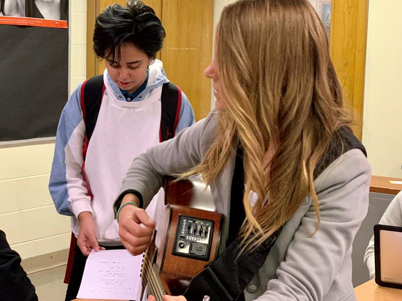 Cleveland high school freshman Justine Guerra (left) practices lyrics with singer-songwriter Diana Chittester