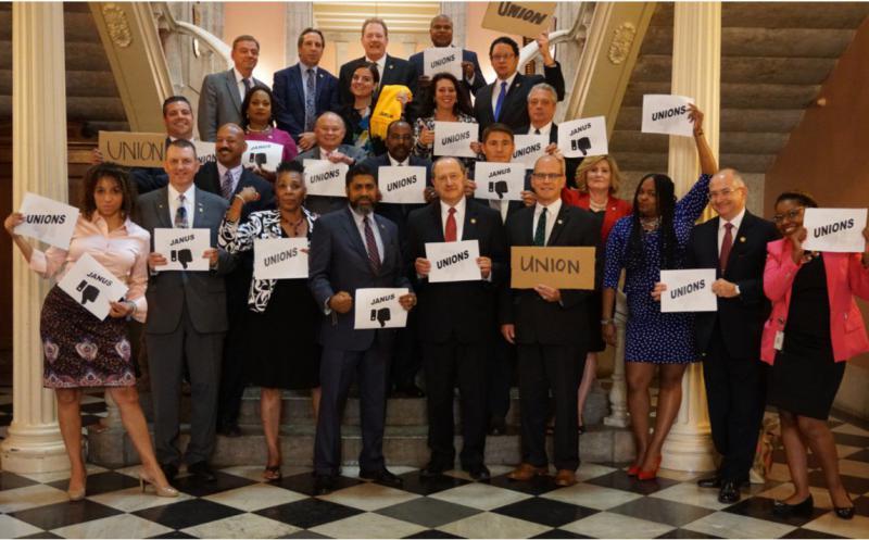 Ohio House Democratic Caucus with union signs.