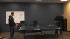Blake Blackburn and Sederick Grant discuss business ideas at Innoplex during a game of ping pong.