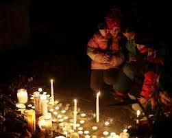Newtown area residents at a vigil in memory of the 26 killed at Sandy Hook elementary