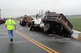 Two salt trucks slid off KY 2551 during icy conditions this morning in Muhlenberg County.