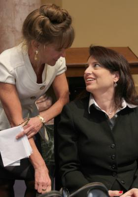 House Majority Caucus Chair Sannie Overly, D-Paris (right), is congratulated by Rep. Kelly Flood, D-Lexington, on her election as the first woman to a leadership post in the Kentucky House of Representatives