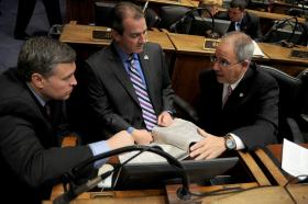 Rep. Jim DeCesare, R-Rockfield (right), discusses legislation with Rep. John Tilley, D-Hopkinsville (left), and Rep. David Osborne, R-Prospect, in the Kentucky House of Representatives.