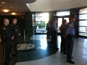 Kentucky State Police troopers and Warren County court security officers stood guard inside the Warren County Justice Center before the results of a grand jury investigation were formally revealed.