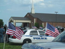 Police officers from across the state and nation are in Bardstown Thursday for the funeral of Officer Ellis.