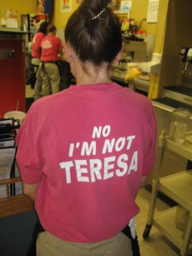 "Waitresses at Teresa's wear these shirts because they are constantly asked, ""Are you Teresa?"""