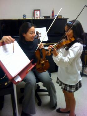 WKU's Ching-Yi Lin gives a lesson to one of her young students.