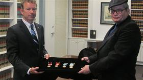 U.S. Senator Rand Paul presented military service medals to Colonel George Hickey, son of Airman 1st Class Billy Hickey in a ceremony in Bowling Green.