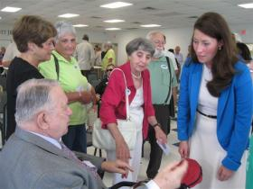 Alison Lundergan Grimes meets supporters during a Warren County stop on Wednesday.