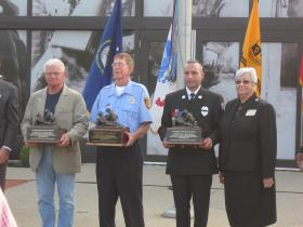 Al Wallace, Dennis Young, and Mark Skipper are in Ft. Knox Wednesday, being recognized for their heroism at the Pentagon. The firefighters were assigned to the Fort Myer Fire Department in Arlington, VA on Sept. 11, 2001.