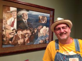 Camp director Mike Compton, with artwork depicting Bill Monroe in the background