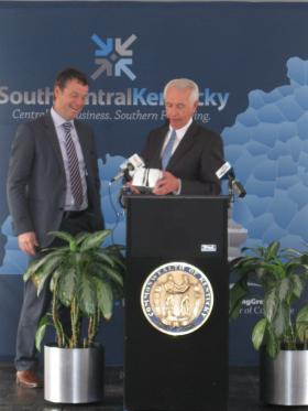 Kentucky Governor Steve Beshear presented a gift to Alpla, Inc. CEO Guenther Lehner.