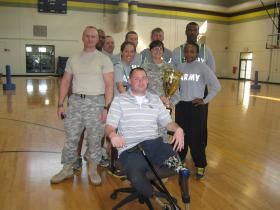 Members of Alpha Company in the Warrior Transition Battalion at Fort Knox hold the trophy they won in a game of Beep Baseball.